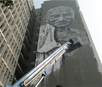 genie artist painting Gahndi new delhi police hq genie s-125 boom lift paint